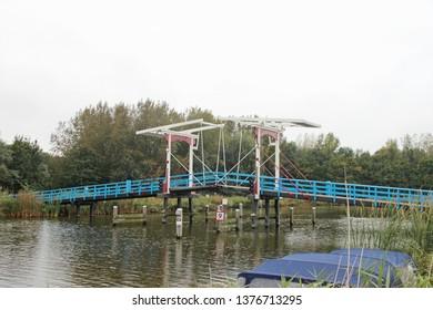 Wooden draw bridge named Pekhuisbrug over river Rotte between Bleiswijk and Zevenhuizen in the Netherlands