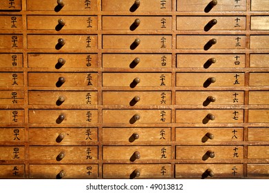 Wooden drawers with Japanese characters in temple, Tokyo