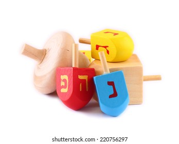 wooden dreidels (spinning top) for hanukkah jewish holiday isolated on white