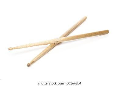 Wooden drum sticks against a white background
