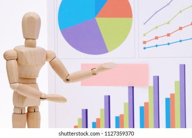 Wooden dummy with color chart printed documents on white background