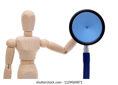 Wooden dummy hand holding stethoscope, Health checkup concept