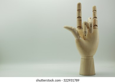 Wooden dummy hand point sign isolated white background