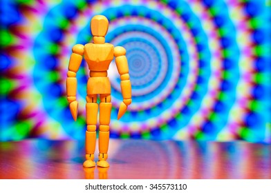 Wooden dummy, mannequin or man figurine, silhouette stand against the backdrop of hipnotic or trance background.