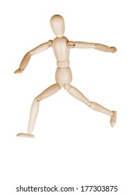 Wooden dummy in a pose of the running person