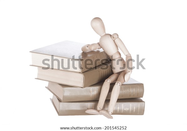 Wooden Dummy Sits On Books Stock Photo (Edit Now) 201545252