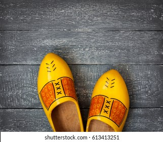 Wooden Dutch shoes are on the old painted floor