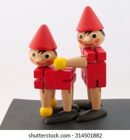 Wooden dwarfs positioned in a sexually suggestive way symbolizing doggy style