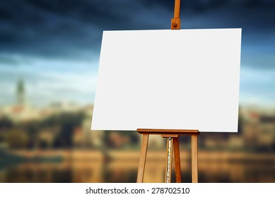Wooden easel with blank painting canvas as copy space for mock up paintwork