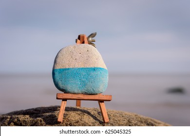 Wooden easel on the boulder at the sea
