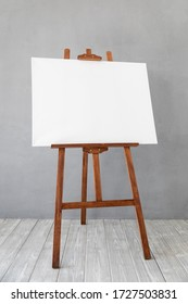 Wooden easel with white canvas blank in studio. Copy space for your text