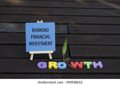 wooden easel  written banking, financial and investment with word growth using colorful alphabets block concepts.