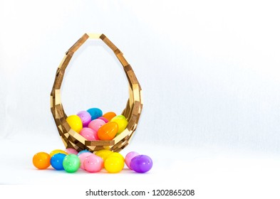 Wooden Easter basket filled with colorful eggs.
