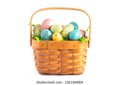 A Wooden Easter Basket Filled with Decorated Eggs Isolated on a White Background