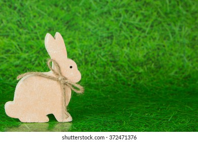 wooden easter bunny with grass