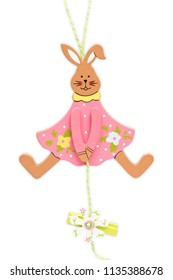 wooden easter bunny hanging on white background