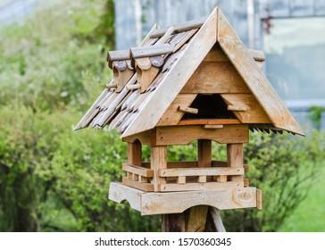 wooden eco bird feeder. animal protection concept