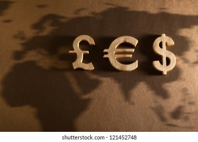 Wooden economy and currency unit on a craft background