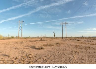 wooden electrical pylons in desert
