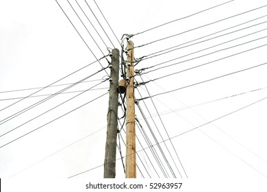 wooden electricity post against gray sky