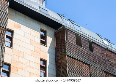 Wooden elements in facade. Architectural detail of a modern apartament building.