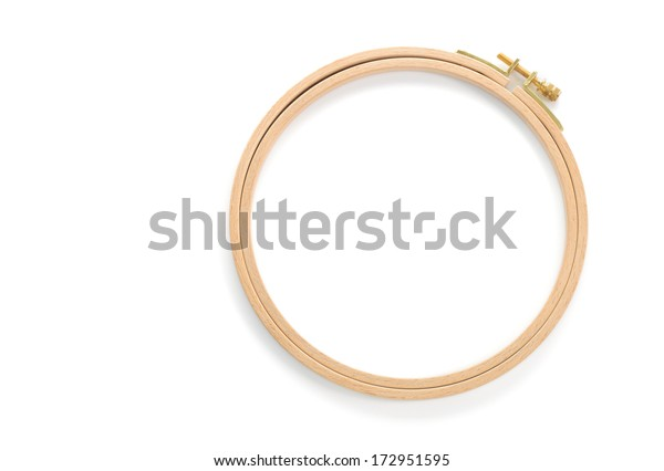 Wooden embroidery hoop isolated on white background.