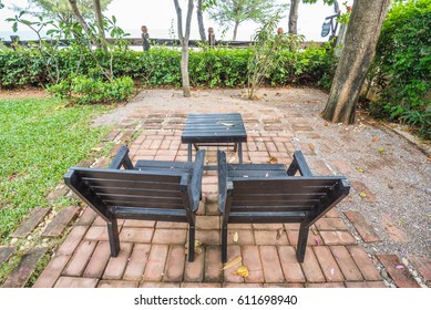 wooden empty chair in garden