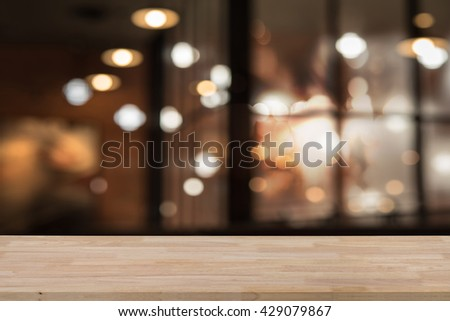 16c6e1ea Wooden empty table top with defocus of shopping mall with bokeh light  background, use for