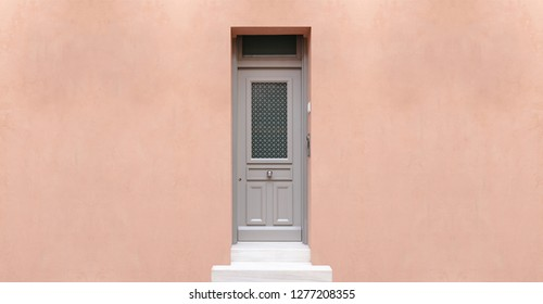 Wooden entrance door, pastel color wall background, residential building in old town of Plaka, Athens Greece, copy space