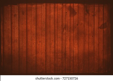 Wooden exterior panels outside a red barn in Scandinavia. Rough and with stains in Sweden