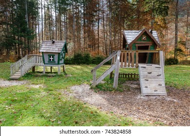 Wooden fairytale treehouse, playing house on children playground with stairs and climbing wall