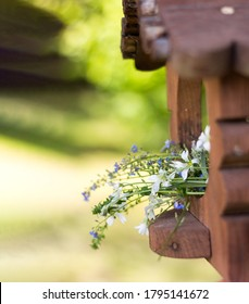 Wooden feeder with flowers. Spring background.Spring background screensavers