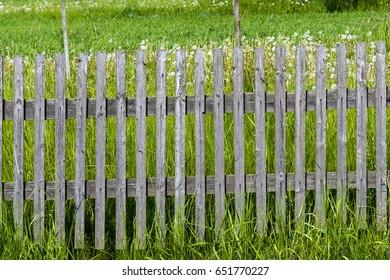 A wooden fence around the garden