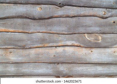 Wooden fence background with old planks of weatherd wood tiled together