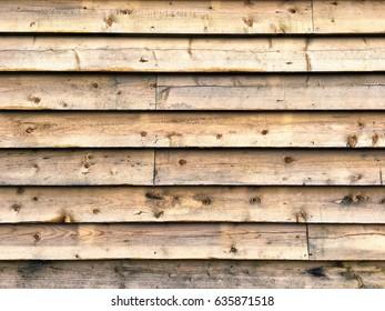 Wooden fence; background of wooden plank fence; landscape format