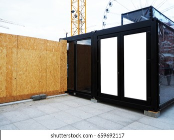 Wooden fence of construction site with modern black office room, glass empty place for street ads, advertisement board, mock up, mockup, signage, urban, industrial background.