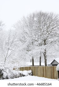wooden fence cover in snow from winter storm