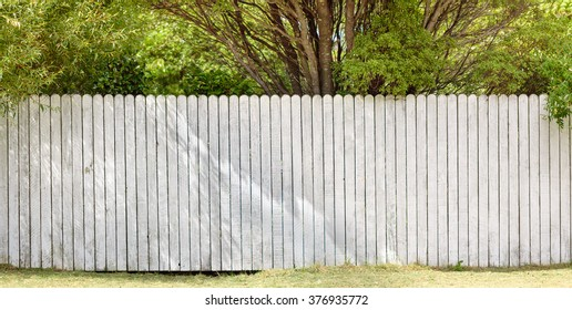 wooden fence in front of garden