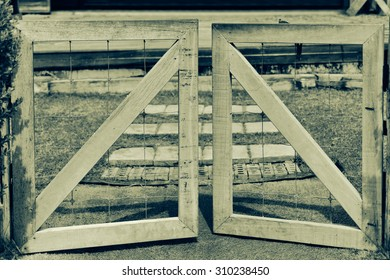 wooden fence and gate open to farm