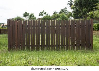 wooden fence with grass field in the park