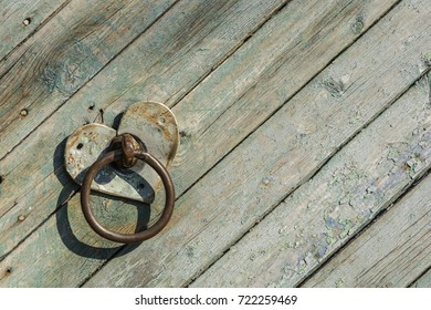 Wooden fence green with old metal handle