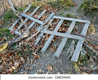 Wooden fence knocked down.