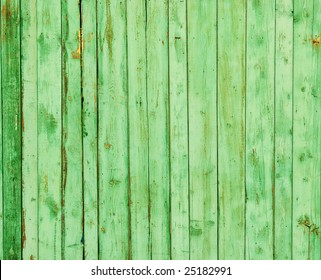 Wooden fence on all background, with traces of a paint