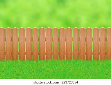 Wooden fence on a green background.
