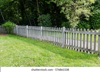 Wooden fence on private property land separated from walking path, Woking, Surrey