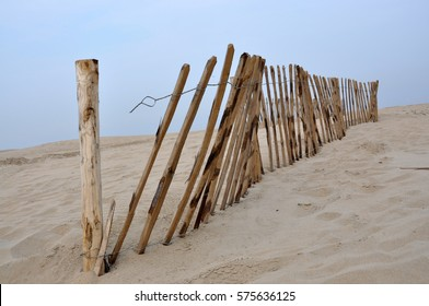 Wooden fence on a sandy beach, the Netherlands