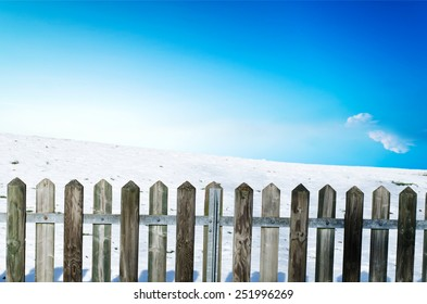 Wooden fence on a snow slope