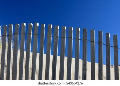 Wooden fence on the sunny beach