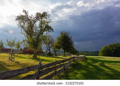 wooden fence at paddock in south germany city wangen bavaria style with sun beams evening in summer