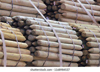 Wooden Fence Posts bundled for delivery